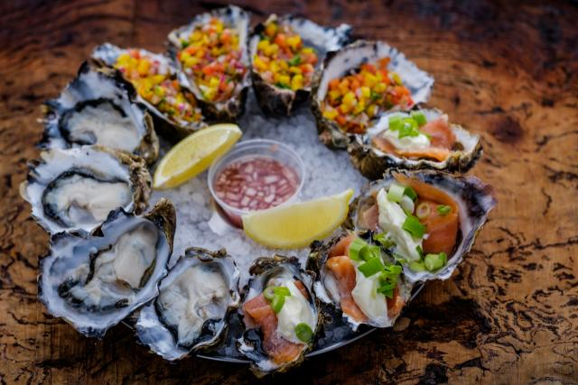 A spectacular trio of a dozen oysters, ready to devour